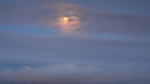 golden moon inclouds