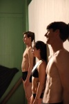 Three dancers of LEVYDance, (Luke, Bianca, and Scott) line up in formation against thewall…
